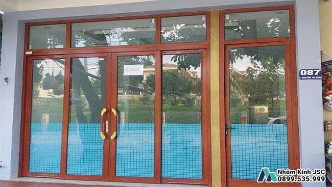 Cửa Nhôm Xingfa Màu Vân Gỗ Cao Cấp - Nhôm Kính JSC Đã Thi Công